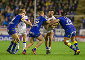 23rd March 2018, Halliwell Jones Stadium, Warrington, England; Betfred Super League rugby, Warrington Wolves versus Wakefield Trinity; Tinirau Arona tackled by Jack Hughes (l) and Ben Murdoch-Masila (r)