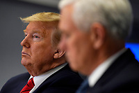 United States President Donald J. Trump listens during a teleconference with governors at the Federal Emergency Management Agency headquarters, Thursday, March 19, 2020, in Washington, DC. US Vice President Mike Pence is at right. <br /> Credit: Evan Vucci / Pool via CNP/AdMedia