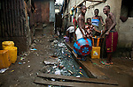 Children collect buckets of water next to an open sewer in Mabella quarter, Freetown, Sierra Leone, Aug. 15, 2012. Médecins Sans Frontières Belgium, in collaboration with the Sierra Leone Ministry of Health, is running four emergency cholera treatment centers to keep up with the number of patients. Many of the roughly 120 daily patients seen by the MSF team come from extremely impoverished areas of the densely-populated capital, where proper systems for drainage and waste disposal are almost non-existent. Outbreaks of water-borne diseases like cholera become even more likely during the rainy season, which is expected to last at least two more months.