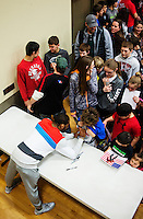 Olympic Gold champion wrestler Jordan Burroughs (cq) meets and signs autographs with young wrestlers at a wrestling tournament at Sidney High School in Sidney, Nebraska, Sunday, February 14, 2015. Burroughs has become a celebrity in the wrestling world due to his success on the mat.<br /> <br /> Photo by Matt Nager