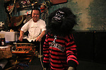 """October 22, 2016, Utsunomiya, Japan - A Japanese macaque Yume (meaning dream) wears a mask of gorilla as she shows her performance at an izakaya, Japanese pub """"Kayabuki"""" in Utsunomiya, 100km north of Tokyo on Saturday, October 22, 2016. The pub master Kaoru Otsuka trains Japanese macaques to help him and show their entertainment skills to attract customers including lots of foreign tourists.   (Photo by Yoshio Tsunoda/AFLO) LWX -ytd-"""