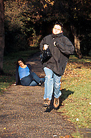 Woman being mugged in a park. The mugger ran towards her and grabbed her handbag pushing her over as he ran off with it..©shoutpictures.com..john@shoutpictures.com