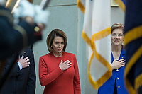 United States House Minority Leader Nancy Pelosi (Democrat of California), left, and US Senator Elizabeth Warren (Democrat of Massachusetts), right stand at attention as the United States National Anthem is played during a ceremony dedicating a chair in the United States Capitol Building to honor United States soldiers labeled as 'Prisoners of War' or 'Missing in Action' at the United States Capitol Building in Washington, D.C. on November 8th, 2017. <br /> Credit: Alex Edelman / CNP /MediaPunch