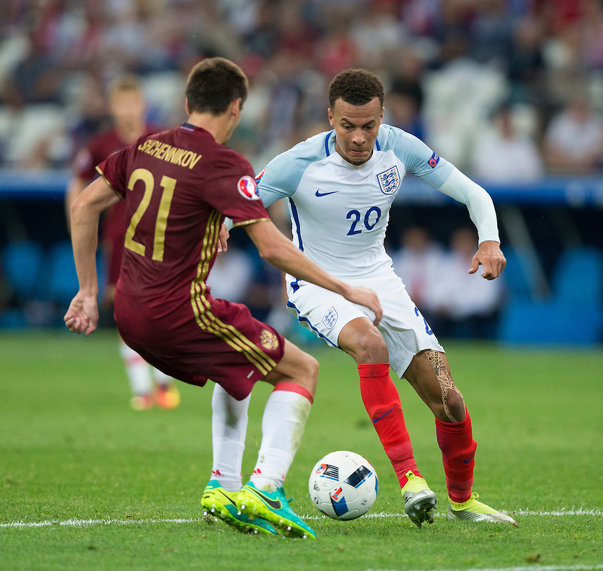England's Dele Alli takes on Russia's Georgi Shchennikov (and goes on to win a free-kick from which England score)<br /> <br /> Photographer Craig Mercer/CameraSport<br /> <br /> International Football - 2016 UEFA European Championship - Group B - England v Russia - Saturday 11th June 2016 - Stade Velodrome, Marseille - France <br /> <br /> World Copyright &copy; 2016 CameraSport. All rights reserved. 43 Linden Ave. Countesthorpe. Leicester. England. LE8 5PG - Tel: +44 (0) 116 277 4147 - admin@camerasport.com - www.camerasport.com