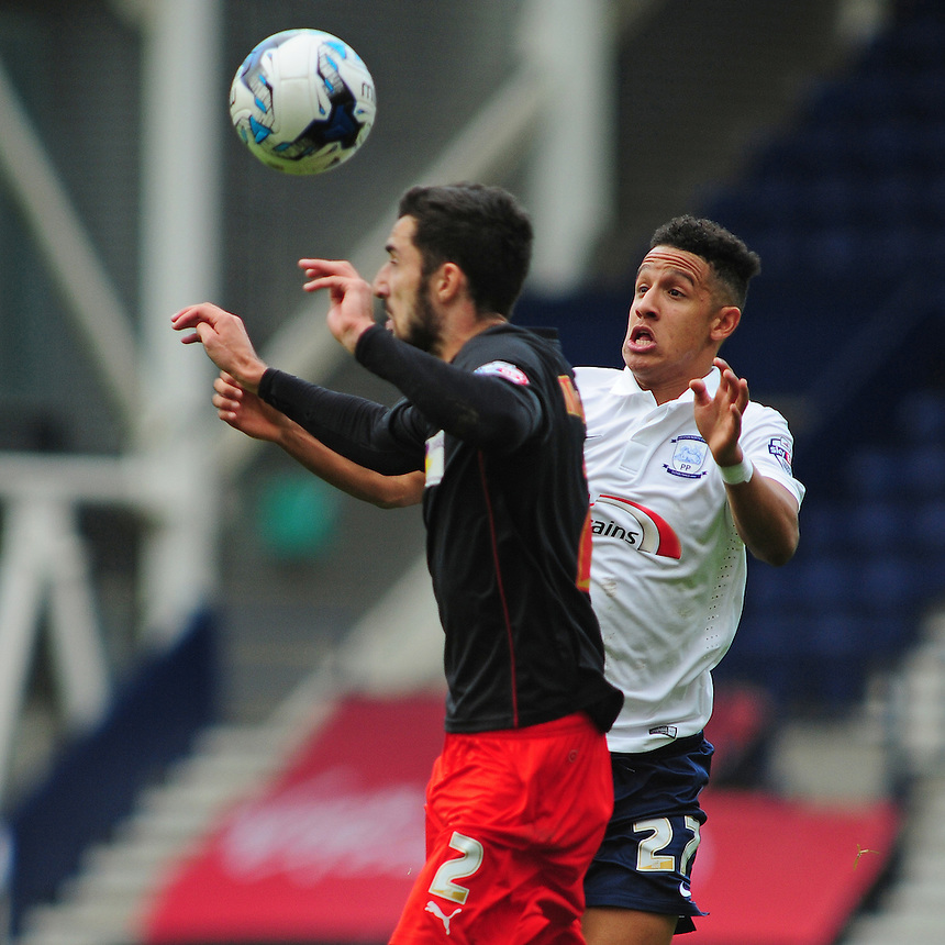 Preston North End&rsquo;s Callum Robinson vies for possession with Fleetwood Town's Conor McLaughlin<br /> <br /> Photographer Chris Vaughan/CameraSport<br /> <br /> Football - The Football League Sky Bet League One - Preston North End v Fleetwood Town - Saturday 25th October 2014 - Deepdale - Preston<br /> <br /> &copy; CameraSport - 43 Linden Ave. Countesthorpe. Leicester. England. LE8 5PG - Tel: +44 (0) 116 277 4147 - admin@camerasport.com - www.camerasport.com