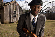 Justin Robinson of the Carolina Chocolate drops poses with his violin.