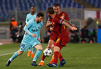 FC Barcelona Lionel Messi, left, is challenged by Roma s Aleksandar Kolarov, center, and Daniele De Rossi during the Uefa Champions League quarter final second leg football match between AS Roma and FC Barcelona at Rome's Olympic stadium, April 10, 2018.<br /> UPDATE IMAGES PRESS/Riccardo De Luca