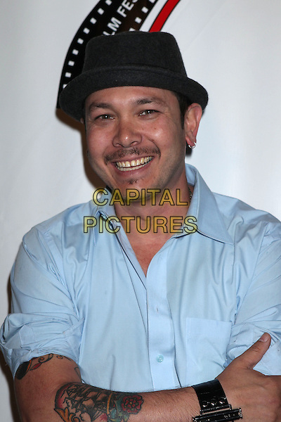 Brian Ronalds<br /> 13th annual Polish film festival at American Cinematheque's Egyptian Theatre, Hollywood, California, USA.<br /> 9th October 2012<br /> headshot portrait blue shirt black hat tattoo<br /> CAP/ADM/RE<br /> &copy;Russ Elliot/AdMedia/Capital Pictures