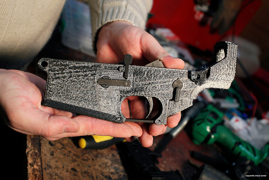 Chapman Baetzel holding a custom two-part lower receiver that he made for his AR 15 rifle using a 3D printer at his home in Dover N.H, Thursday, Jan. 17, 2013. Baetzel finished off the gun part with a purchased trigger kit assembly.  (Cheryl Senter for the New York Times)
