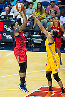 Washington, DC - July 22, 2016: Washington Mystics center Kia Vaughn (9) shoots a jump shot over Los Angeles Sparks forward Candace Parker (3) during their match up at the Verizon Center in Washington, DC. (Photo by Phil Peters/Media Images International)