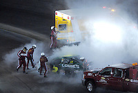 Apr 20, 2007; Avondale, AZ, USA; Safety personnel put out a fire on the car of Nascar Busch Series driver Kyle Busch (5) during the Bashas Supermarkets 200 at Phoenix International Raceway. Mandatory Credit: Mark J. Rebilas