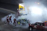 Apr 20, 2007; Avondale, AZ, USA; Safety personnel put out a fire on the car of Nascar Busch Series driver Kyle Busch (5) during the Bashas Supermarkets 200 at Phoenix International Raceway. Mandatory Credit: Mark J. Rebilas