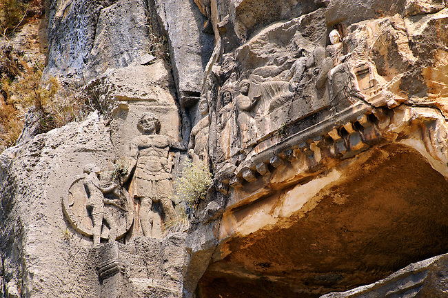 Pictures & images of the ancient Lycian rock cut tomb of a Gladiator whose rock relief sculpture can be seen with his family ,  Myra, Anatolia, Turkey.