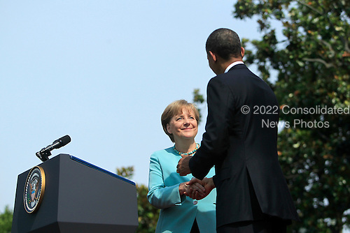 Chancellor Angela Merkel of Germany, left, shakes hands with United States President Barack Obama following her remarks during a welcoming ceremony on the South Lawn of the White House in Washington, D.C., U.S., on Tuesday, June 7, 2011. .Credit: Andrew Harrer / Pool via CNP