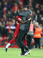 27th October 2019; Anfield, Liverpool, Merseyside, England; English Premier League Football, Liverpool versus Tottenham Hotspur; Liverpool manager Jurgen Klopp lifts Sadio Mane of Liverpool off his feet after the final whistle - Strictly Editorial Use Only. No use with unauthorized audio, video, data, fixture lists, club/league logos or 'live' services. Online in-match use limited to 120 images, no video emulation. No use in betting, games or single club/league/player publications