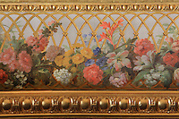 "Detail of gilded moulding and floral painting of the guard-rail of the first balcony, Theatre Imperial Napoleon III de Fontainebleau (Fontainebleau Theatre Napoleon III), 1853-1856, by Hector Lefuel, Fontainebleau, Seine-et-Marne, France. Restoration of the theatre began in Spring 2013 thanks to an agreement between the Emirate of Abu Dhabi and the French Governement dedicating 5 M€ to the restoration.  In recognition of the sponsorship by the Emirate of Abu Dhabi, French Governement decided to rename the theatre as ""Theatre Cheikh Khalifa bin Zayed Al Nahyan"" (Cheikh Khalifa bin Zayed Al Nahyan Theatre). The achievement of the first stage of renovation has allowed the opening of the theatre to the public on May 3, 2014. Picture by Manuel Cohen"