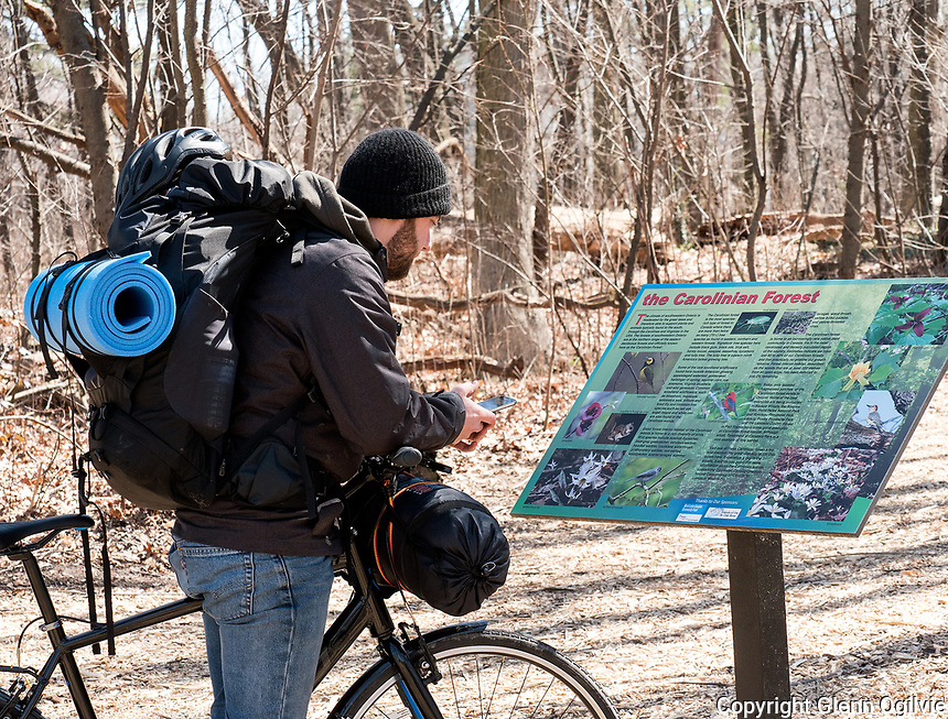 Philipp Czakert,  of Germany reads an information panel about the Carolinian Forest of Tarzanland. Philipp made a brief stop in Sarnia while on a two month bike tourof Canada and the United States. The bio medical engineering student was using his phone to locate a place to stay overnight with like minded travellers in the area.