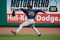 Mobile BayBears Jo Adell (25) throws the ball in during a Southern League game against the Mobile BayBears on July 25, 2019 at Hank Aaron Stadium in Pensacola, Florida.  Pensacola defeated Mobile 2-1 in the first game of a doubleheader.  (Mike Janes/Four Seam Images)