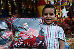 A picture taken on May 8, 2018 show an Egyptian boy carries a pillow with a photo of Egyptian player Mohammed Salah at a market ahead of the holy Muslim month of Ramadan in Cairo, Egypt. Ramadan is sacred to Muslims because it is during that month that tradition says the Koran was revealed to the Prophet Mohammed. The fast is one of the five main religious obligations under Islam. Muslims around the world will mark the month, during which believers abstain from eating, drinking, smoking and having sex from dawn until sunset. Photo by Amr Sayed