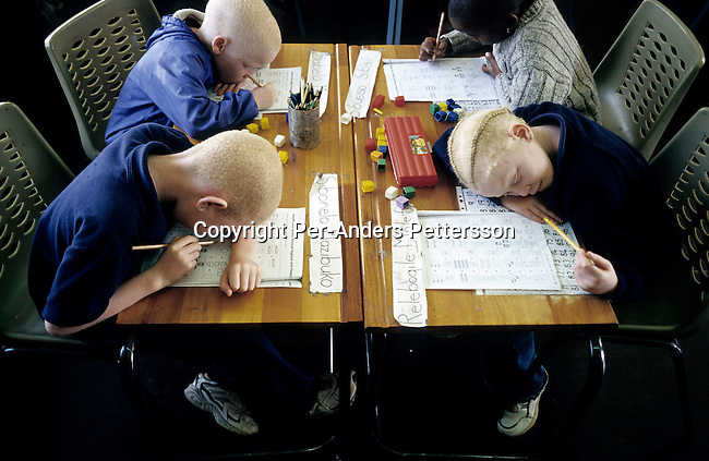 KLIPRIVER, SOUTH AFRICA APRIL 16: Sabelo Masondo, age 7, Sibonelo Mazibuko, age 7, Sibusiso Sibisi, age 7, Relebogile Molefe, age 7, read during a class on April 16, 2003 at Sibonile (means: we have seen) School for the Blind in Klipriver, south of Johannesburg, South Africa. A blind woman founded the school in 1994. The school has about 125 students from disadvantaged communities around South Africa. Many of the children have faced rejection from their families and communities, and at Sibonile they have a chance for a good education. (Photo: Per-Anders Pettersson)..