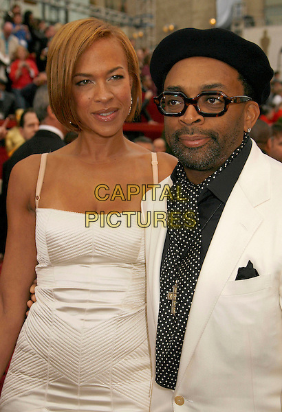 SPIKE LEE & GUEST.The 79th Annual Academy Awards - Arrivals held at the Kodak Theatre, Hollywood, California, USA,.February 25th, 2007..oscars red carpet half length black hat glasses shirt tie polka dot white dress jacket suit.CAP/ADM/RE.©Russ Elliot/AdMedia/Capital Pictures...
