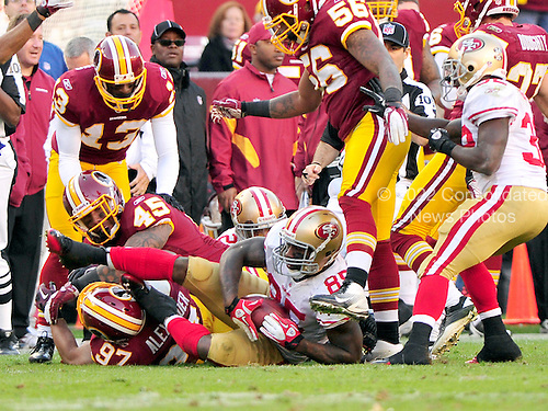 San Francisco 49ers tight end Vernon Davis (85) recovers an on-side kick in the fourth quarter of their game against the Washington Redskins at FedEx Field in Landover, Maryland on Sunday, November 6, 2011.  Pictured with Davis are Redskins defenders Lorenzo Alexander (97), Mike Sellers (45), Anthony Armstrong (13), and Perry Riley (56).  The 49ers won the game 19 - 11..Credit: Ron Sachs / CNP