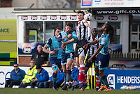 Calum Dyson of Grimsby Town wins the ball in the air during the Sky Bet League 2 match between Grimsby Town and Wycombe Wanderers at Blundell Park, Cleethorpes, England on 4 March 2017. Photo by Andy Rowland / PRiME Media Images.