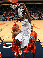 Virginia forward Akil Mitchell (25) dunks the ball in front of Clemson  defenders during the game Thursday in Charlottesville, VA. Virginia defeated Clemson 78-41.