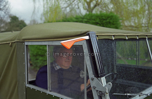 Brian Bashall, founder of Dunsfold Landrovers and the Dunsfold Collection of Land Rovers, demonstrating the trafficators on his perfectly restored and award winning 1953 Land Rover Series One 80. Dunsfold, UK, 2001. --- No releases available. Automotive trademarks are the property of the trademark holder, authorization may be needed for some uses. --- Dunsfold Landrovers (DLR) was established in 1968 in Dunsfold, Surrey, UK. Due to the ever growing number of Land Rover vehicles the Dunsfold Collection of Land Rovers was launched in 1993. Supported by the company Land Rover and the Gaydon Heritage Centre today Dunsfold is maintaining the biggest and most varied collection of Land Rovers in the world.