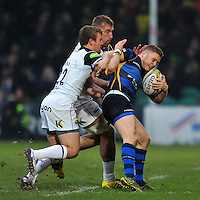Luke Baldwin of Worcester Warriors is tackled by Dominic Day and Jonathan Evans of Bath Rugby. Aviva Premiership match, between Worcester Warriors and Bath Rugby on February 13, 2016 at Sixways Stadium in Worcester, England. Photo by: Patrick Khachfe / Onside Images