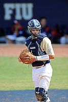 18 March 2012:  FIU catcher Aramis Garcia (44) looks for a sign from the bench as the Florida Atlantic University Owls defeated the FIU Golden Panthers, 9-3, at University Park in Miami, Florida.