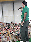 Academy Award-winning actor and comedian Robin Williams performs for more than 300 airmen and soldiers deployed here December 18, 2003.  Also with him were Olympic gold medalist and professional wrestler Kurt Angle, NASCAR driver Mike Wallace and former model and television personality Leeann Tweeden. .Mandatory Credit: A.C. Eggman - U.S. Air Force via CNP
