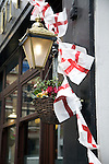 English Saint George cross flags outside pub, London, England