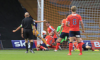 Luton Town defender Johnny Mullins blocks a shot with his body during the Sky Bet League 2 match between Luton Town and Yeovil Town at Kenilworth Road, Luton, England on 13 August 2016. Photo by Liam Smith.