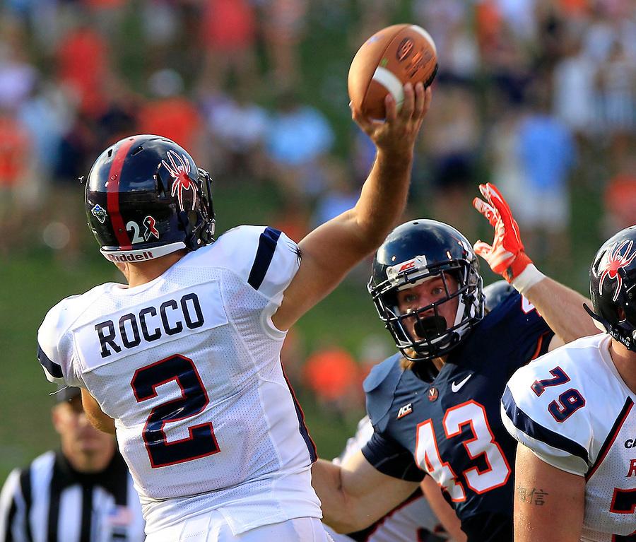 Virginia defensive end Trent Corney (43) puts pressure on Richmond quarterback Michael Rocco (2) during the game Saturday Sept. 6, 2014 at Scott Stadium in Charlottesville, VA. Virginia defeated Richmond 45-13. Photo/Andrew Shurtleff