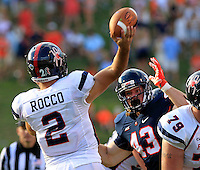 Virginia defensive end Trent Corney (43) puts pressure on Richmond quarterback Michael Rocco (2) during the game Saturday Sept. 6, 2014 at Scott Stadium in Charlottesville, VA. Virginia defeated Richmond 45-13. Photo/Andrew Shurtleff