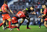 Francois Louw of Bath Rugby is tackled by Duane Vermeulen of Toulon. European Rugby Champions Cup match, between RC Toulon and Bath Rugby on January 10, 2016 at the Stade Mayol in Toulon, France. Photo by: Patrick Khachfe / Onside Images