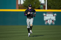 Holy Cross Crusaders center fielder Austin Masel (9) jogs off the field between innings of the game against the South Carolina Gamecocks at Founders Park on February 15, 2020 in Columbia, South Carolina. The Gamecocks defeated the Crusaders 9-4.  (Brian Westerholt/Four Seam Images)
