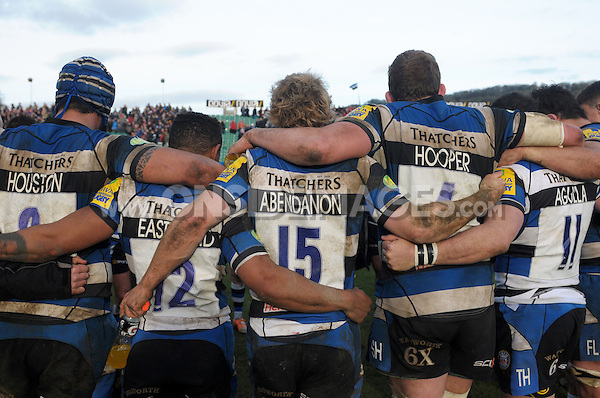 The Bath team huddle together after the match. Aviva Premiership match, between Bath Rugby and London Wasps on February 22, 2014 at the Recreation Ground in Bath, England. Photo by: Patrick Khachfe / Onside Images