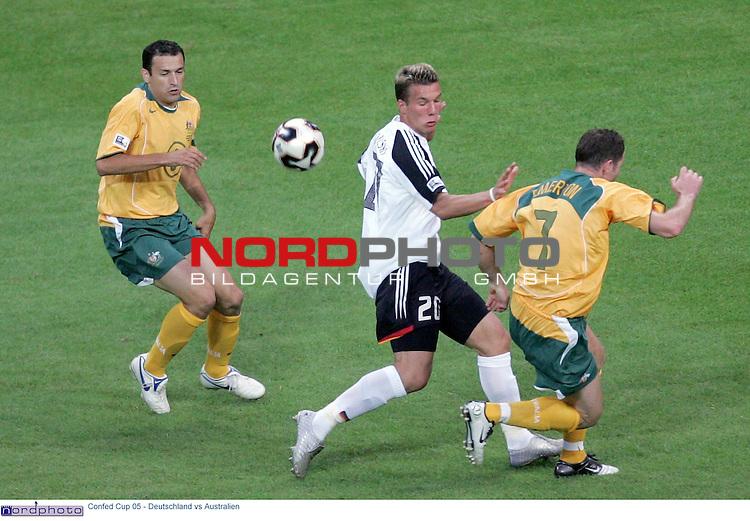FIFA CONFEDERATIONS Cup 2005 Play 2<br /> <br /> Deutschland - Australien<br /> <br /> <br /> <br /> <br /> <br /> Lukas Podolski (mi) gegen Kevin Muscat (li) und Brett Emerton (re)<br /> <br /> <br /> <br /> Foto &copy; nordphoto <br /> <br /> <br /> <br />  *** Local Caption *** Foto ist honorarpflichtig! zzgl. gesetzl. MwSt.<br /> <br />  Belegexemplar erforderlich<br /> <br /> Adresse: nordphoto<br /> <br /> Georg-Reinke-Strasse 1<br /> <br /> 49377 Vechta
