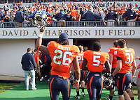 Oct 30, 2010; Charlottesville, VA, USA;  Virginia Cavaliers linebacker Ausar Walcott (26), Virginia Cavaliers running back Torrey Mack (5) and Virginia Cavaliers linebacker Walker Hobby (31) walk off the field after the 24-19 upset win over the Miami Hurricanes at Scott Stadium. Mandatory Credit: Andrew Shurtleff