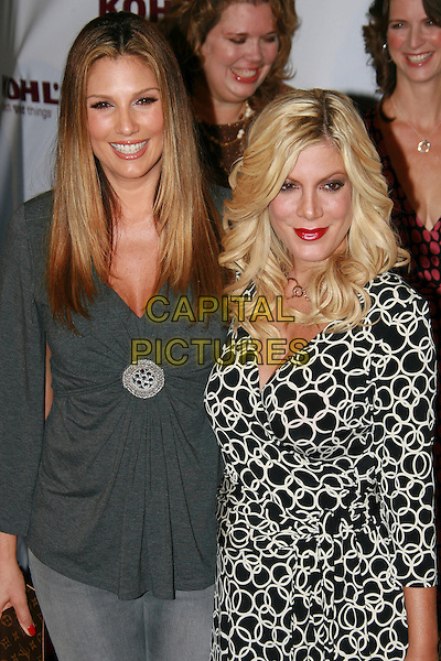 DAISY FUENTES & TORI SPELLING .Kohl's and Conde Nast Host Kohl's Transformation Nation Fall Fashion Show - Arrivals held at the Santa Monica Pier, Santa Monica, California, USA..October 12th, 2006.Ref: ADM/ZL.half length grey gray top black white dress brooch.www.capitalpictures.com.sales@capitalpictures.com.©Zach Lipp/AdMedia/Capital Pictures.