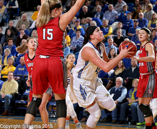 BROOKINGS, SD - JANUARY 25: Ellie Thompson #45 from South Dakota State University eyes the basket past Taylor Frederick #15 from the University of South Dakota during their game Thursday night at Frost Arena in Brookings. (Photo by Dave Eggen/Inertia)