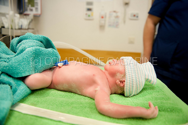 Illustration picture of a newborn baby just after birth going through the first medical check-up (Heverlee, 30/12/2016)
