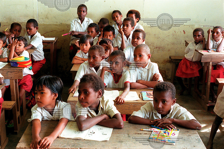 West-Papua / Merauke, February 2000 - The first classes of the Roman Catholic primary school of Buti, a fisher's village east of Merauke, on the southcoast of West-Papua. The class is crowded because one of the teachers is on pregnancy leave..© Rob Huibers
