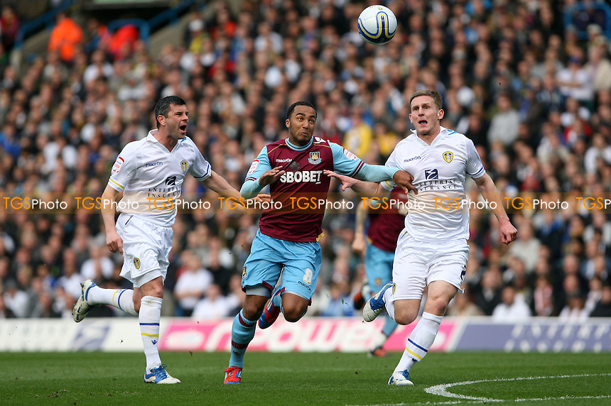Nicky Maynard of West Ham gets in between Leeds pair Paul Robinson and Tom Lees - Leeds United vs West Ham United, npower Championship at Elland Road, Leeds - 17/03/12 - MANDATORY CREDIT: Rob Newell/TGSPHOTO - Self billing applies where appropriate - 0845 094 6026 - contact@tgsphoto.co.uk - NO UNPAID USE..