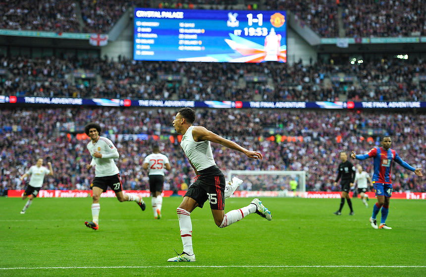Manchester United's Jesse Lingard celebrates scoring his sides winning goal  <br /> <br /> Photographer Ashley Western/CameraSport<br /> <br /> Football - The Emirates FA Cup Final - Crystal Palace Manchester United - Saturday 21st May 2016 - Wembley - London<br /> <br /> &copy; CameraSport - 43 Linden Ave. Countesthorpe. Leicester. England. LE8 5PG - Tel: +44 (0) 116 277 4147 - admin@camerasport.com - www.camerasport.com