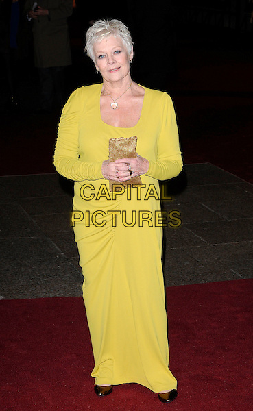 DAME JUDI DENCH .Attending the World Premiere of the film 'NINE' held at the Odeon cinema Leicester Square, London, England, UK,  3rd December 2009..full length long maxi dress sleeved sleeves gold clutch bag green yellow chartreuse shiny shoes ruched.CAP/CAN.©Can Nguyen/Capital Pictures.