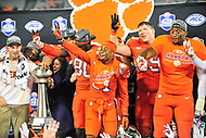 Charlotte, NC - DEC 2, 2017: Clemson Tigers cornerback Ryan Carter (31) Tigers tight end Milan Richard (80) defensive end Austin Bryant (7) celebrate on stage after winning the ACC Championship game over Miami 38-3 at Bank of America Stadium Charlotte, North Carolina. (Photo by Phil Peters/Media Images International)