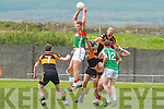 Padraig King for St Michaels/Foilmore wins this aerial battle against Stacks Kieran Donaghy.